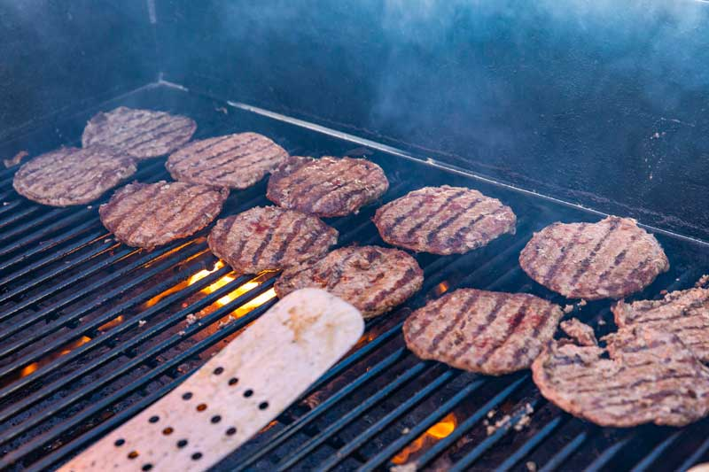Outdoor Grilling Hamburgers by Maximilian's Catering